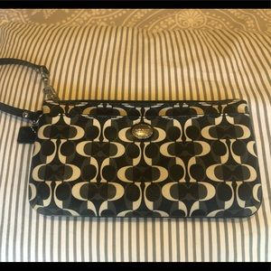 Coach wallet/clutch with strap.